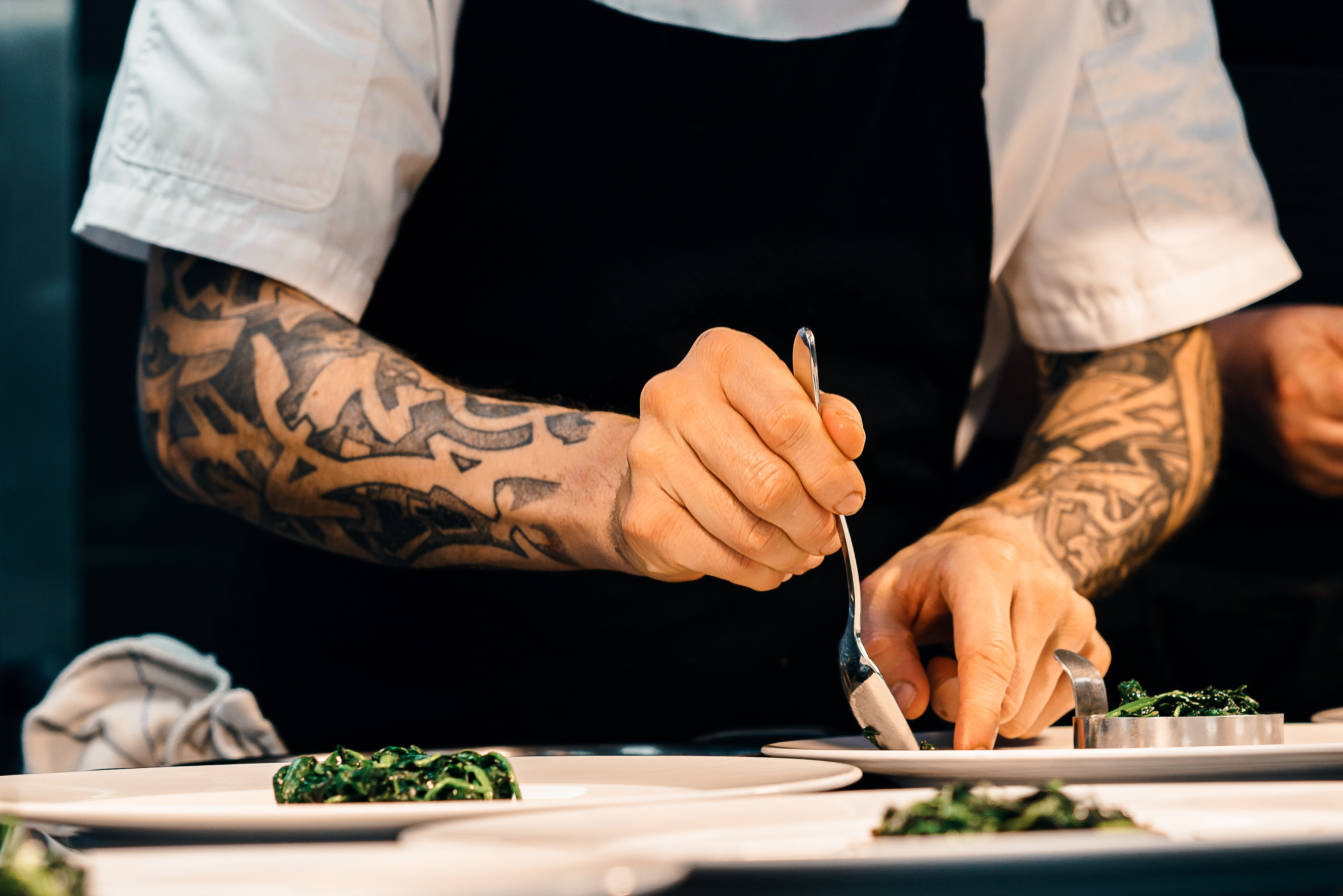 A chef prepares a meal at a restaurant